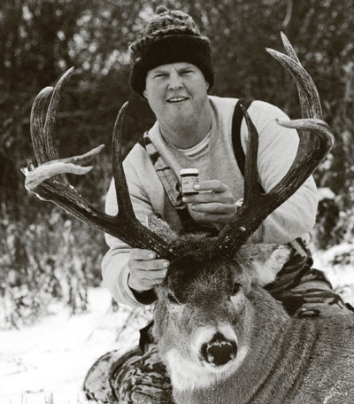 John Collins posing with a 9-point buck