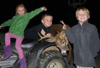 Matt Shumlas's children with prize deer